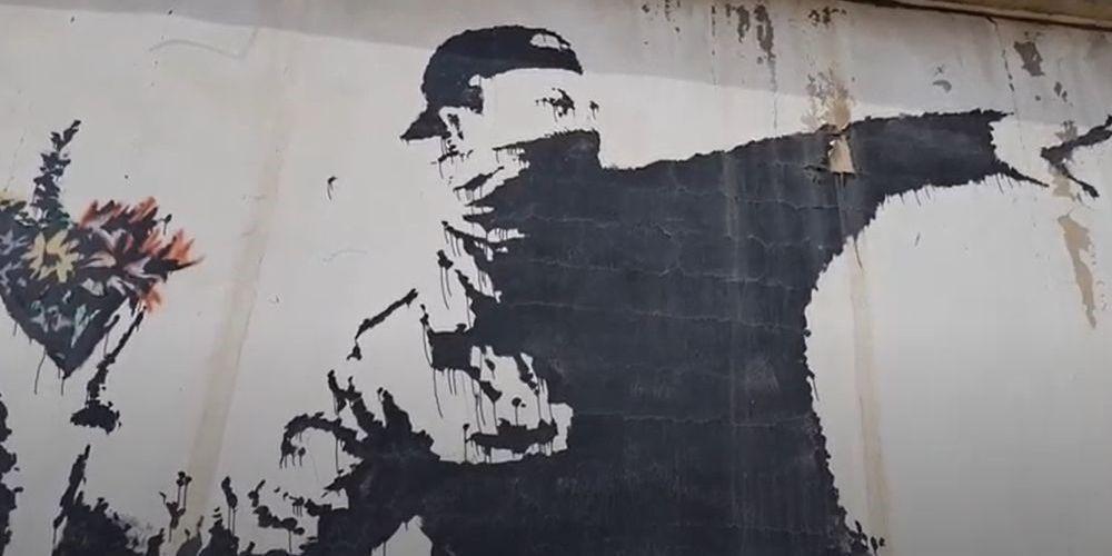 Le « Lanceur de Fleurs » de Banksy.